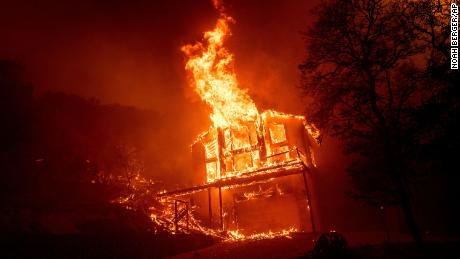 A home burns as the LNU Lightning Complex fires tear through the Spanish Flat community in unincorporated Napa County, Calif., Tuesday, Aug. 18, 2020.
