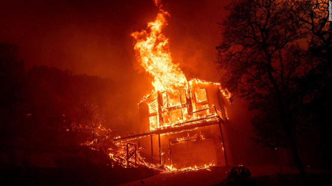 A home burns as the LNU Lightning Complex fires tear through the Spanish Flat community in Napa County on August 18.