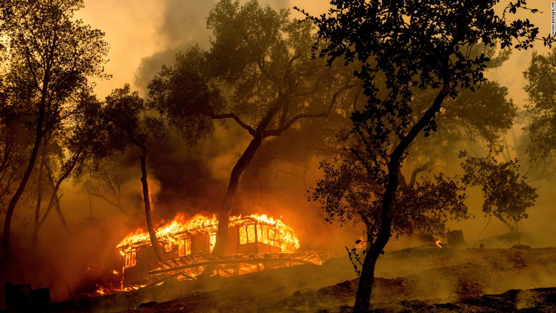 Flames from the Hennessy Fire consume a cabin at the Nichelini Family Winery in Napa County.