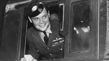 Douglas Bader poses on a new Southern Railway engine at Brighton, England, wearing an engine driver's peaked cap in September 1947.