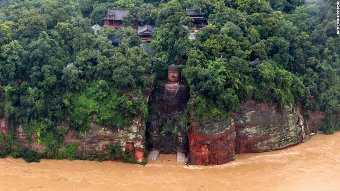 Flood waters reach toes of famous Buddha statue