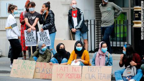 Students hold placards as they protest outside the Department for Education in central London on August 14.