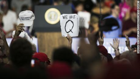 Facebook says it's cracking down on thousands of QAnon-linked accounts and groups