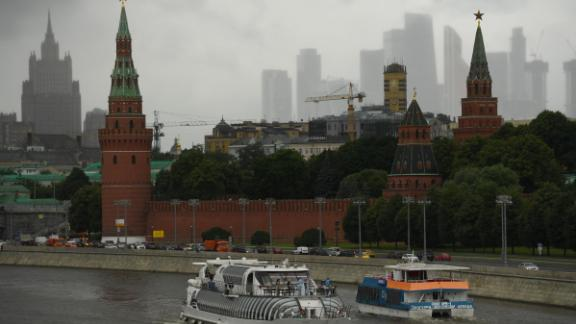 Leisure boats float on the Moskva river in front of the Kremlin, with the Russian Foreign Ministry building and skyscrapers of Moscow's International Business Centre (Moskva City) seen in the background, in downtown Moscow on July 16, 2020. (Photo by Kirill KUDRYAVTSEV / AFP) (Photo by KIRILL KUDRYAVTSEV/AFP via Getty Images)