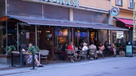 Sweden has recorded its highest number of deaths during the first half of the year since 1869, when the country was struck by famine. Pictured, a cafe in Stockholm.