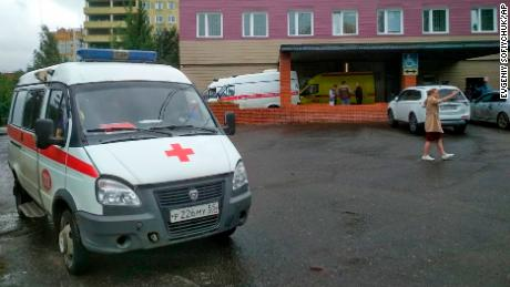 An ambulance parked next to a building of a hospital intensive care unit where Navalny was hospitalized in Omsk, Russia.