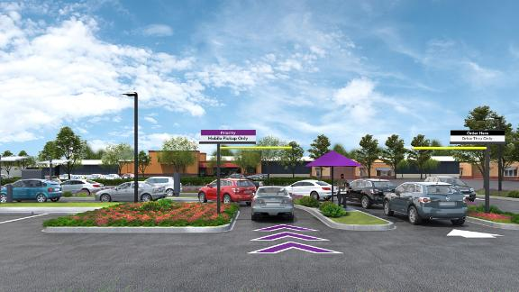 A rendering of Taco Bell's new concept, which has two drive-thrus.