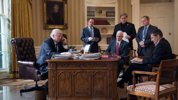 Bannon stands in the Oval Office as President Donald Trump speaks on the phone with Russian President Vladimir Putin, on January 28, 2017. Also pictured, from left, are former White House Chief of Staff Reince Priebus, Vice President Mike Pence, former Press Secretary Sean Spicer and former national security adviser Michael Flynn.