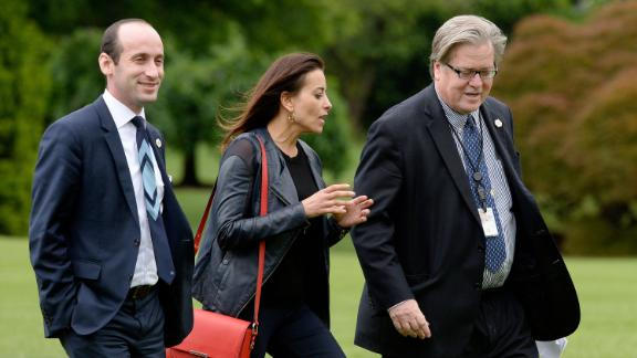 Senior adviser Stephen Miller, former deputy national security adviser Dina Powell and Bannon exit Marine One on the South Lawn of the White House in May 2017.