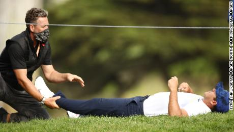 Koepka receives treatment on day two of the 2020 PGA Championship.