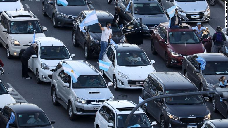 Protesters in cars drive along 9 de Julio Avenue waving flags in Buenos Aires on Monday.