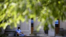 A student studies Tuesday outside the closed Wilson Library on the campus of the University of North Carolina at Chapel Hill.