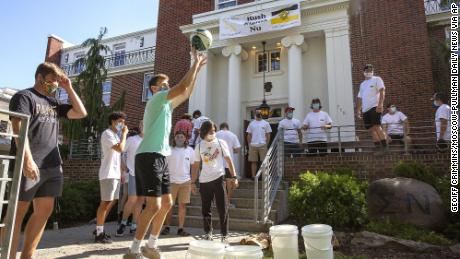 University of Idaho students wear face masks while playing a game outside of Sigma Nu fraternity during fraternity bid day, the final day of the recruitment process, on Monday, Aug. 17, 2020, in Moscow, Idaho.