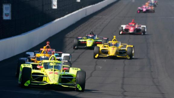 Simon Pagenaud, of France, leads a group of cars into turn one during a practice session for the Indianapolis 500 auto race at Indianapolis Motor Speedway, Sunday, Aug. 16, 2020, in Indianapolis. (AP Photo/Darron Cummings)