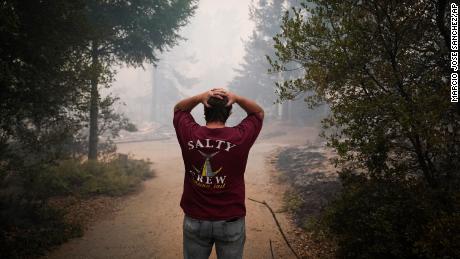 Peter Koleckar reacts Thursday after seeing homes burned  in the Santa Cruz County communituy of Bonny Doon.