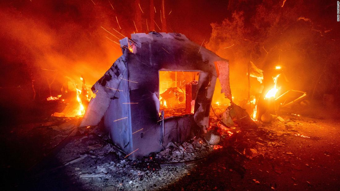 Flames from the Lightning Complex fires consume a home in Napa County, California, on August 19.