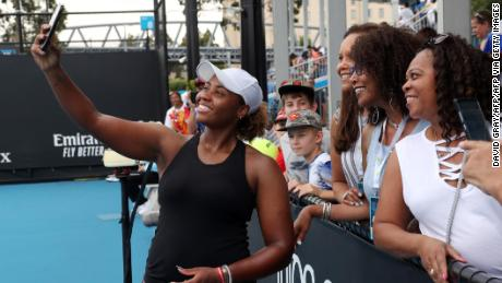 Taylor Townsend poses for a photo with spectators during this year's Australian Open