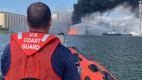 Coast Guard crews respond to a dredge on fire in the Port of Corpus Christi Ship Channel.