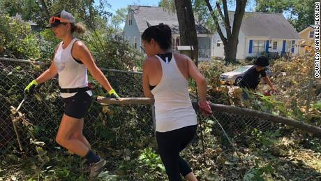 Members of a biking group in Cedar Rapids, Iowa, are now spending their time helping clean up the damage from the massive windstorm that hit the city two weeks ago.