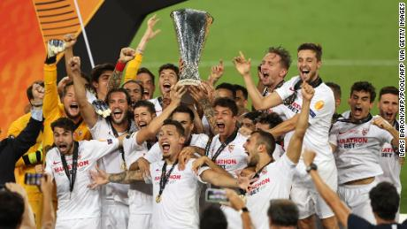 Sevilla's players celebrate after winning the Europa League final over Inter Milan in Cologne, Germany, on Friday, August 21.