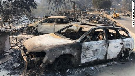 The remains of charred vehicles rest Saturday in a neighborhood near Lake Berryessa in Northern California's Napa County.