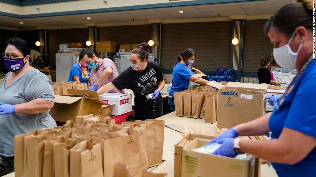 People pack brown-bag lunches at an evacuation center in Santa Cruz, California, on August 21.