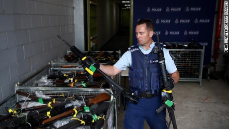 Police Sergeant Jeremy Steedman handles some of the firearms that have been removed from circulation as part of the firearms buyback at the Papakura Police Station on December 21, 2019, in Auckland, New Zealand.