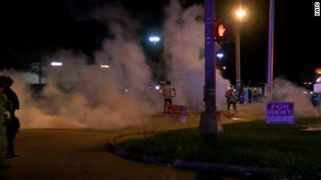 Police in riot gear released flares and smoke canisters into a crowd of protesters on August 22, 2020, CNN affiliate KATC reported.