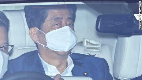 Japan's Prime Minister Shinzo Abe wearing a face mask arrives at Keio University Hospital for a clinical examination in Tokyo on Monday.