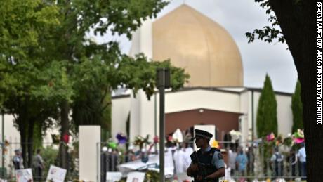 A policeman patrols as delegates and religious leaders wait to enter Al Noor Mosque in Christchurch on March 23, 2019.
