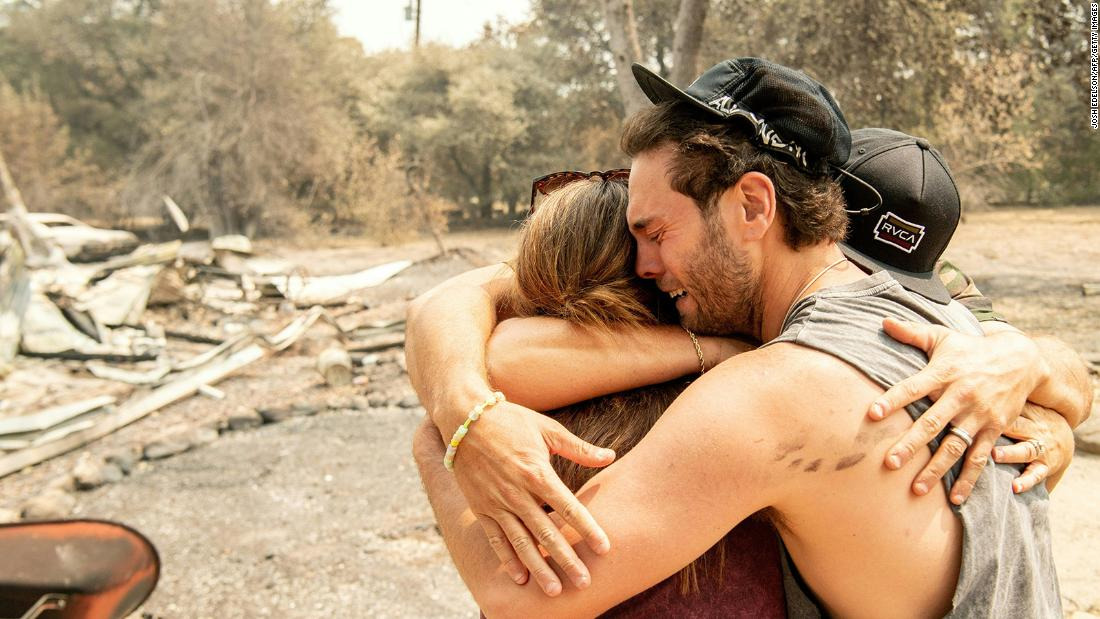 Austin Giannuzzi cries while embracing relatives at the burned remains of their Vacaville home on August 23.