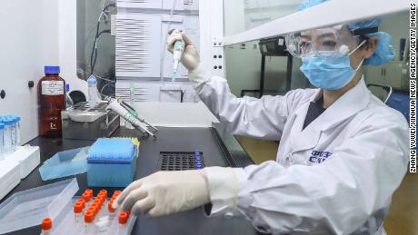 China says it has been vaccinating doctors and frontier workers since July