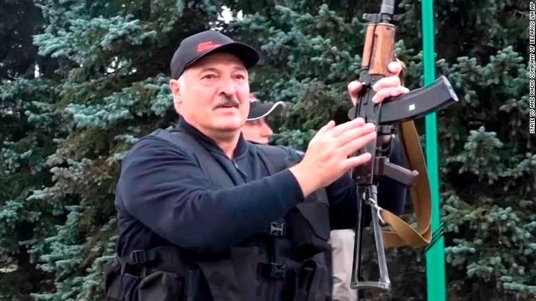 President Alexander Lukashenko brandishing a rifle near the Palace of Independence in Minsk, Sunday, as seen in video from state TV.