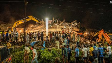 Rescue workers look for survivors after a building collapsed in India's western Maharashtra state.