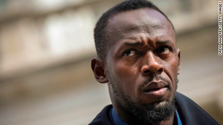 Track star and new Bolt pitchman Usain Bolt looks on during a press conference about the new Bolt Mobility scooter outside of New York City Hall, March 12, 2019 in New York City.