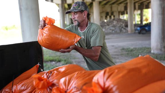 MORGAN CITY, LOUISIANA - AUGUST 24: Ken Allen fills sandbags as he prepares for the arrival of Tropical Storm Marco and possibly Hurricane Laura on August 24, 2020 in Morgan City , Louisiana. The Gulf Coast is expecting to see some impact from Tropical Storm Marco followed by Hurricane Laura.  (Photo by Joe Raedle/Getty Images)
