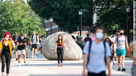 Students wear face masks Monday on the University of Iowa campus in Iowa City, Iowa.