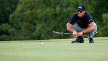 Mickelson lines up a putt on the 13th green during round one of the Charles Schwab Series.
