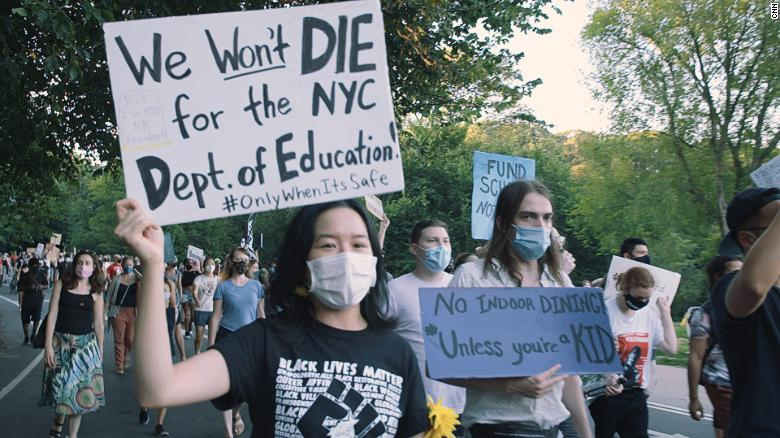 NYC schools: Teachers protest school reopenings with mock caskets and  skeletons - CNN