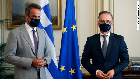Greece's Prime Minister Kyriakos Mitsotakis, left, and Germany's Foreign Minister Heiko Maas met in Athens on Aug. 25, 2020.
