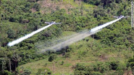 Two AT- 802 planes fumigate coca fields in San Miguel, 400 miles south of Bogota, Colombia, on Dec. 11, 2006.