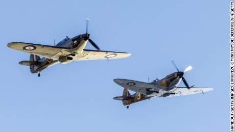 A Hawker Hurricane, left, and  Spitfire, right, are seen over England in April 2020.
