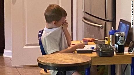 The image of a frustrated kindergartener shows one reality of virtual learning.