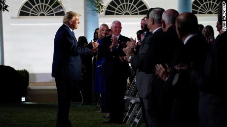 President Donald Trump arrives to listen to First Lady Melania Trump speak at the 2020 Republican National Convention from the White House Rose Garden on Tuesday, August 25, 2020, in Washington.