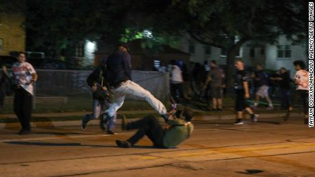Clashes between protesters and armed civilians break out during the protests Tuesday night.