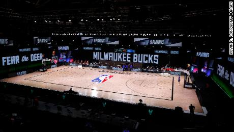 An empty court and bench is shown before the start of a scheduled game between the Milwaukee Bucks and the Orlando Magic.