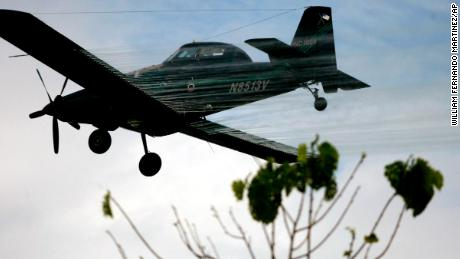 A plane sprays coca fields in San Miguel, on Colombia's southern border with Ecuador on Dec. 15, 2006.