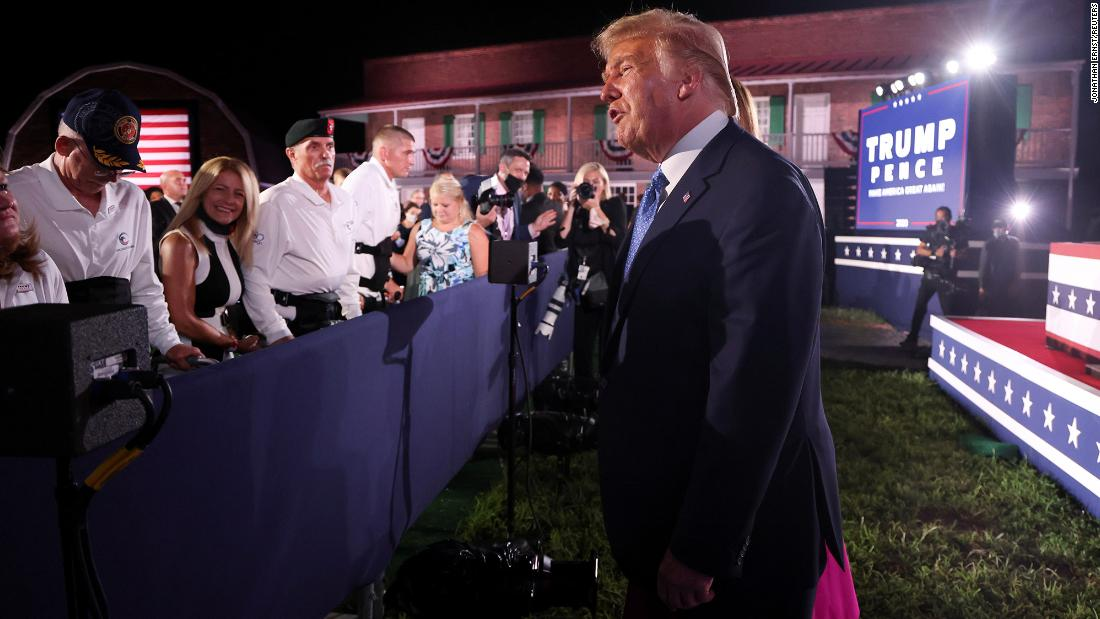 Trump greets the crowd at the White House on August 26 after Vice President Mike Pence gave a speech for the Republican National Convention.
