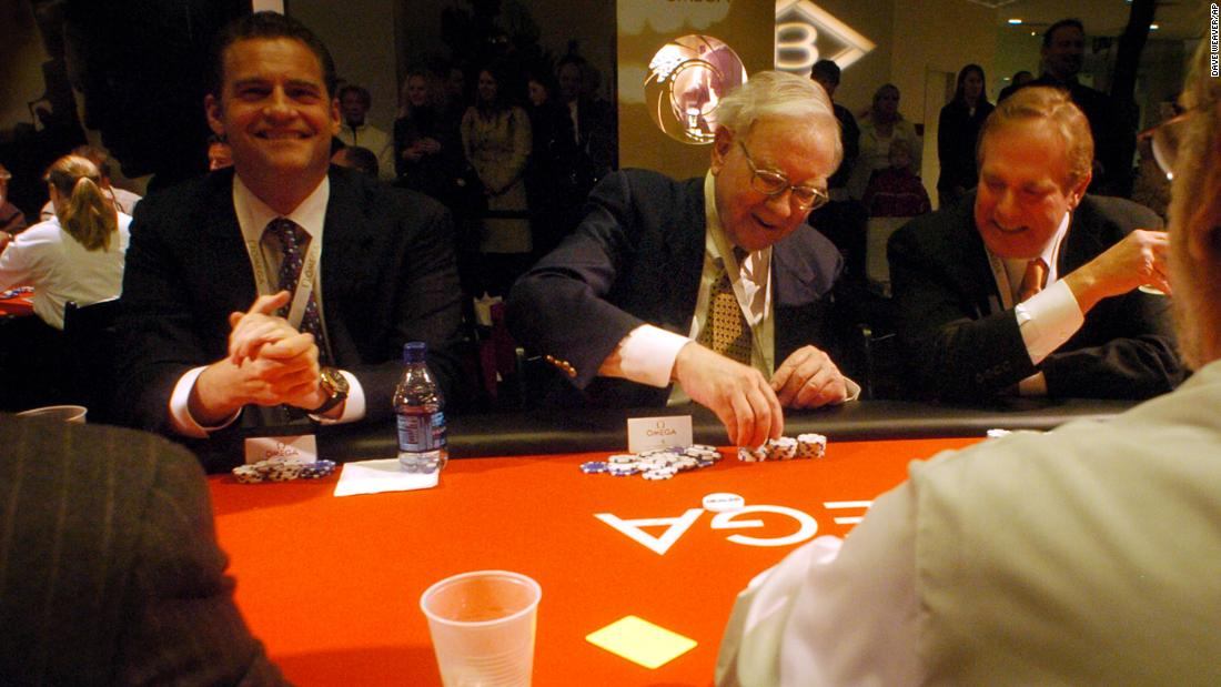 Buffett stacks his chips at a charity poker tournament in Omaha in 2006.