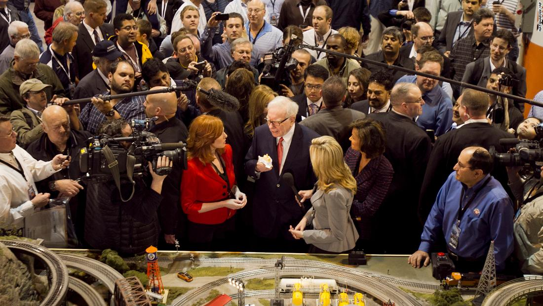 Buffett is mobbed by journalists and shareholders during Berkshire Hathaway's annual shareholders meeting in 2011.